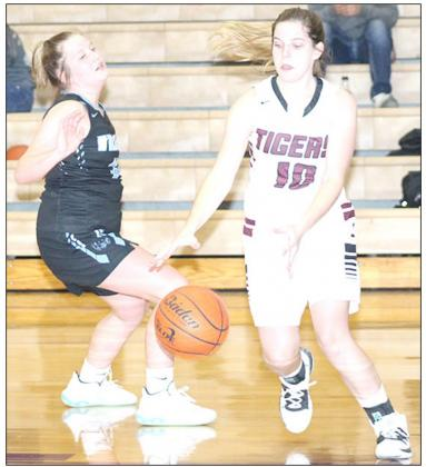 LHS' Masyn Arena (#10, right) drives the baseline past a Cedar Bluffs defender. Paula Jasa/Republican