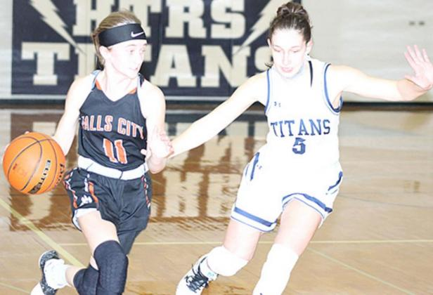 HTRS' Ellie Schaardt (#5, right) defends against a Falls City player in Thursday night's game. Paula Jasa/Republican