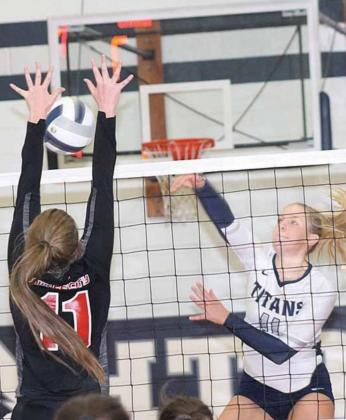 P.C.'s Madison Branek (#11, left) gets her hands on an ace block against HTRS' Katilyn Glathar (#11, right). Paula Jasa/Republican