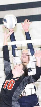 P.C.'s Reyana Tegtmeier (#16) skies at the net to try and tip over HTRS' Katilyn Glathar. Paula Jasa/Republican